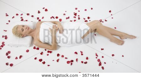 Model Lying With Petals Spread Around