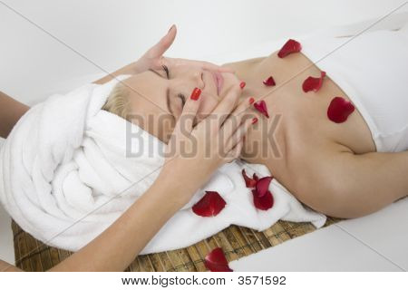 Woman Receiving Face Massage From Female Hands
