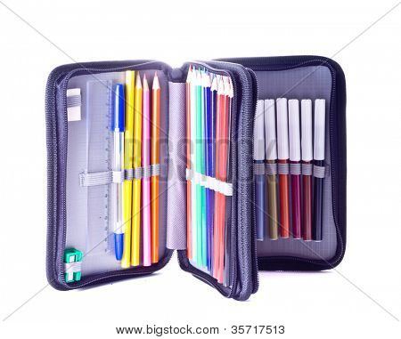 close up of color pencils in pencil case on white background