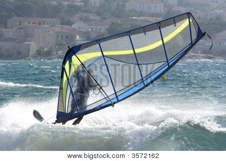 Expert Windsurfer In Strong Wind, Surfing His Board