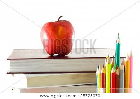books and apple on white background