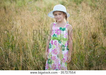 Cute little girl in a summer hat