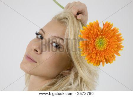 Model With Bright Orange Gerbera