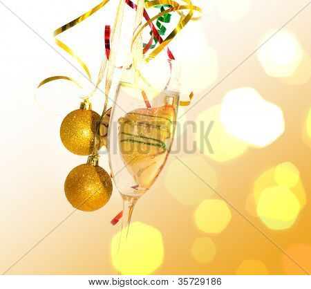 Champagne glass in celebratory scenery