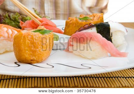 Man Eating an Asian - Japanese Food .