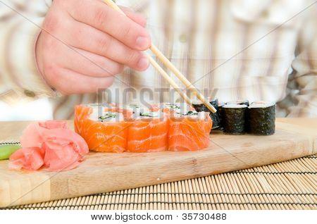 Man Eating an Asian - Japanese Food .