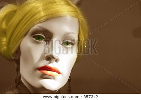 Manikin With Colored Hair Eyes And Lips
