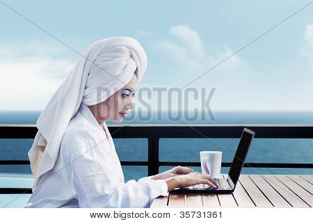 Asian Woman Using Laptop