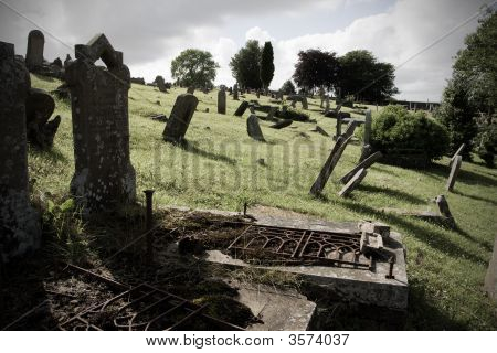 Old Cemetery With Bent Tombstones