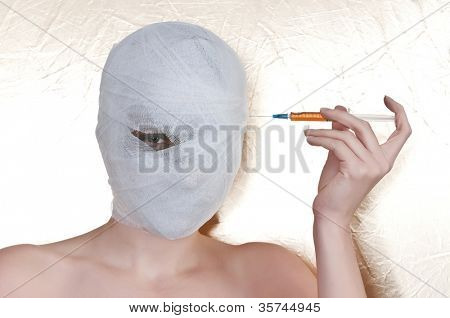beautiful woman with bandage on head.