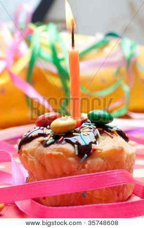 cupcake with sprinkles and candle