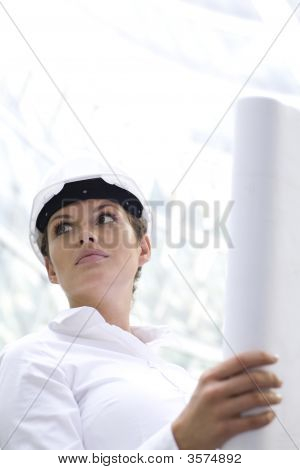Female Architect Holding Blueprints
