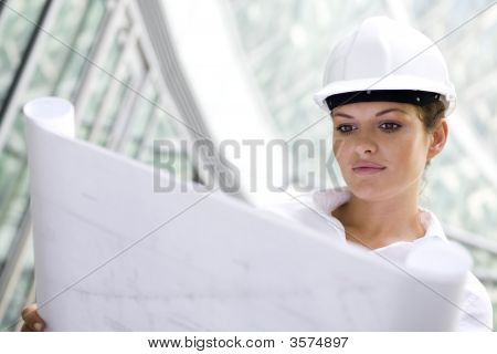Businesswoman Wearing Hardhat Outdoors