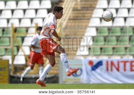 KAPOSVAR, HUNGARY - JULY 21: Unidentified players in action at the VIII. Youth Football Festival U16 Final Pozo Almonte (white) (CHI) vs. FC Makedonija (orange)(MKD) July 21, 2012 in Kaposvar, Hungary