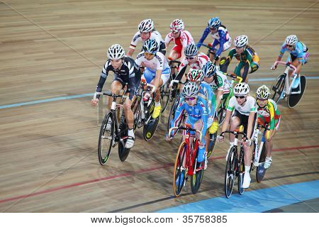 MOSCOW - AUGUST 19: Female cyclists ride on track at UCI juniors track world championships on August 19, 2011 in Moscow, Russia.