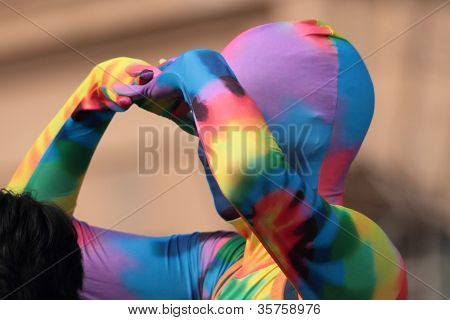 Brisbane, Qld Australia - August 11 : Unidentified Man Hiding Identity In Gay Rainbow Costume   Hold