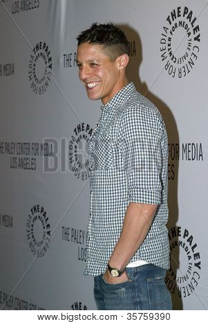 """BEVERLY HILLS - MARCH 7: Theo Rossi arrives at the 2012 Paleyfest """"Sons of Anarchy"""" panel on Wednesday, March 7, 2012 at the Saban Theater in Beverly Hills, CA."""