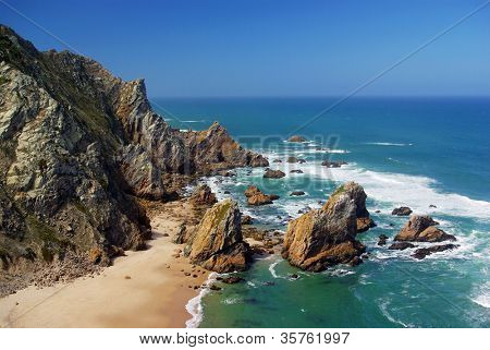 Bird's eye view of the spectacular cliffs of Roca Cape and Ursa beach in Portugal