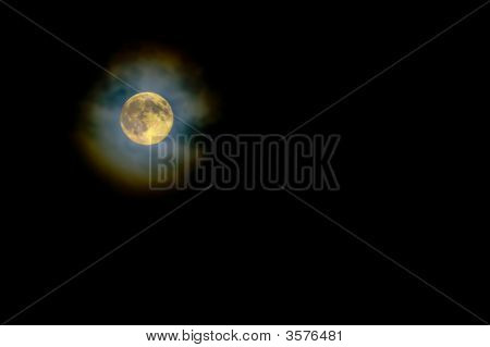 Gold Harvest Moon Through High Light Clouds