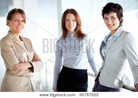 Image of three businesswomen looking at camera
