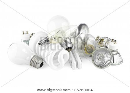 Mixed heap of light bulbs with filament bulbs and energy salving lamps on white