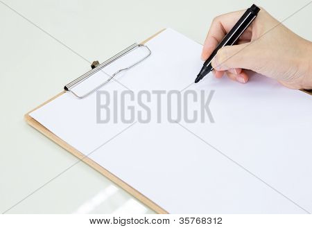 Hand with pen over paper