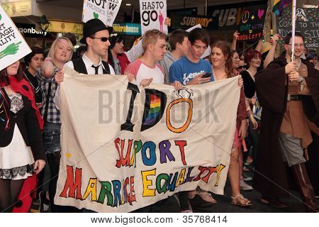 Brisbane, Qld Australia - August 11 : Unidentified Woman With Lesbian Sign On August 11 2012  In Bri