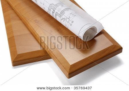Wooden board and plan on a white background
