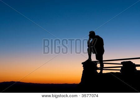 Man Enjoying Amazing View At Sunset