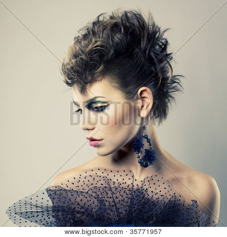 Fashion portrait of a beautiful young lady of punk