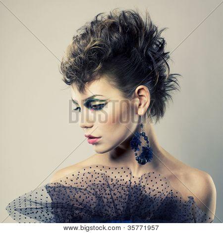Fashion portrait of a beautiful young lady of punk