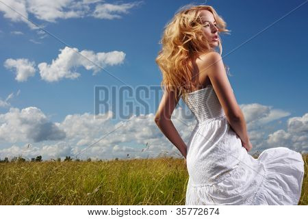 Portrait of beautiful blond woman in a field