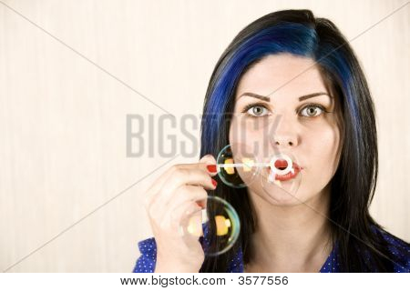 Pretty Woman Blowing Bubbles