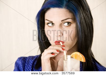 Pretty Woman Sipping A Cocktail