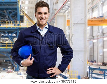 Portrait of a smiling engineer in a construction site