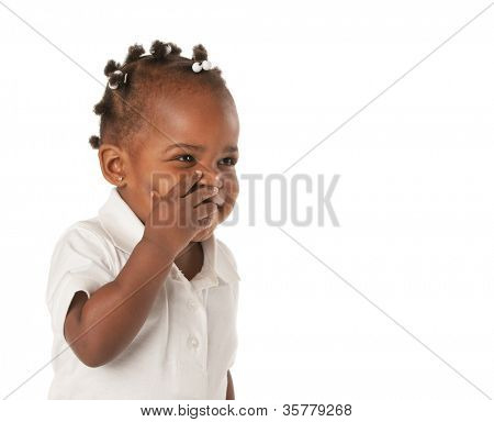 Three Years Old Adorable African American Girl with Braided Hair Covering Face Laughing on White Background