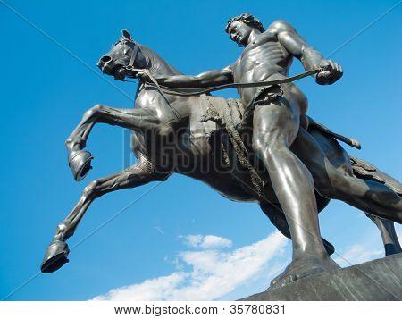 Saint-Petersburg sculpture: The Horse Tamers, designed by the Russian sculptor, Baron Peter Klodt von Urgensburg. Anichkov bridge, Saint-Petersburg, Russia