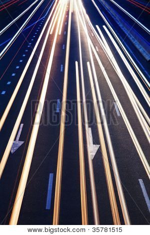 Abstract Real Traffic Road Background / High traffic road with automobile light trails in a rush-hour