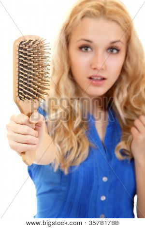 women with hair problem holding loss hair comb in hand, isloated on white background