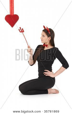 Pretty woman wearing devil costume at valentine's day.