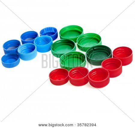 arrow of color plastic bottle cups isolated on white