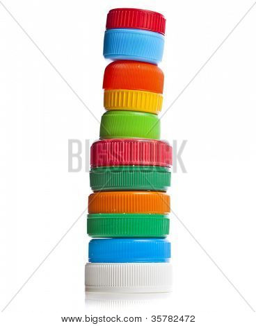 tower of colorful plastic bottle cups isolated on white