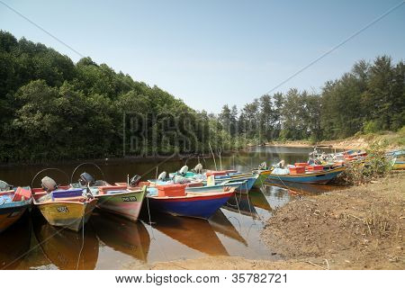 KUANTAN, MALAYSIA - AUG 03: Fishermen boats line up moored on the river bank on August 03, 2012 in Kuantan, Malaysia.  Fishery had been traditionally an important industry in this coastal town.