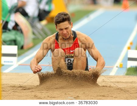 BARCELONA - JULY 10: Tim Nowak of Germany during Long Jump Decathlon event of the 20th World Junior Athletics Championships at the Stadium on July 10, 2012 in Barcelona, Spain