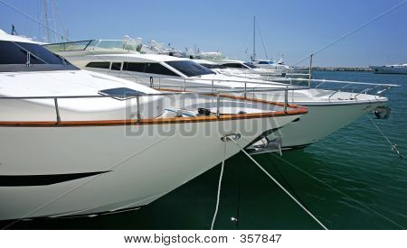 Big Beautiful Stunning And Luxurious White Yachts Moored In Puer