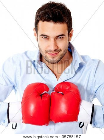 Aggressive businessman with boxing gloves - isolated over a white background