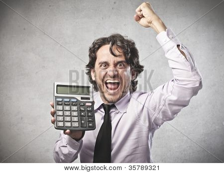 Triumphing businessman showing a calculator