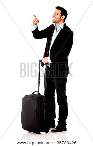 Businessman traveling and pointing at something - isolated over white