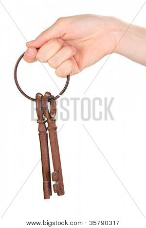 woman's hand holding a bunch of antique keys on white background