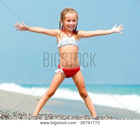 beautiful girl on a beach lifted hands up